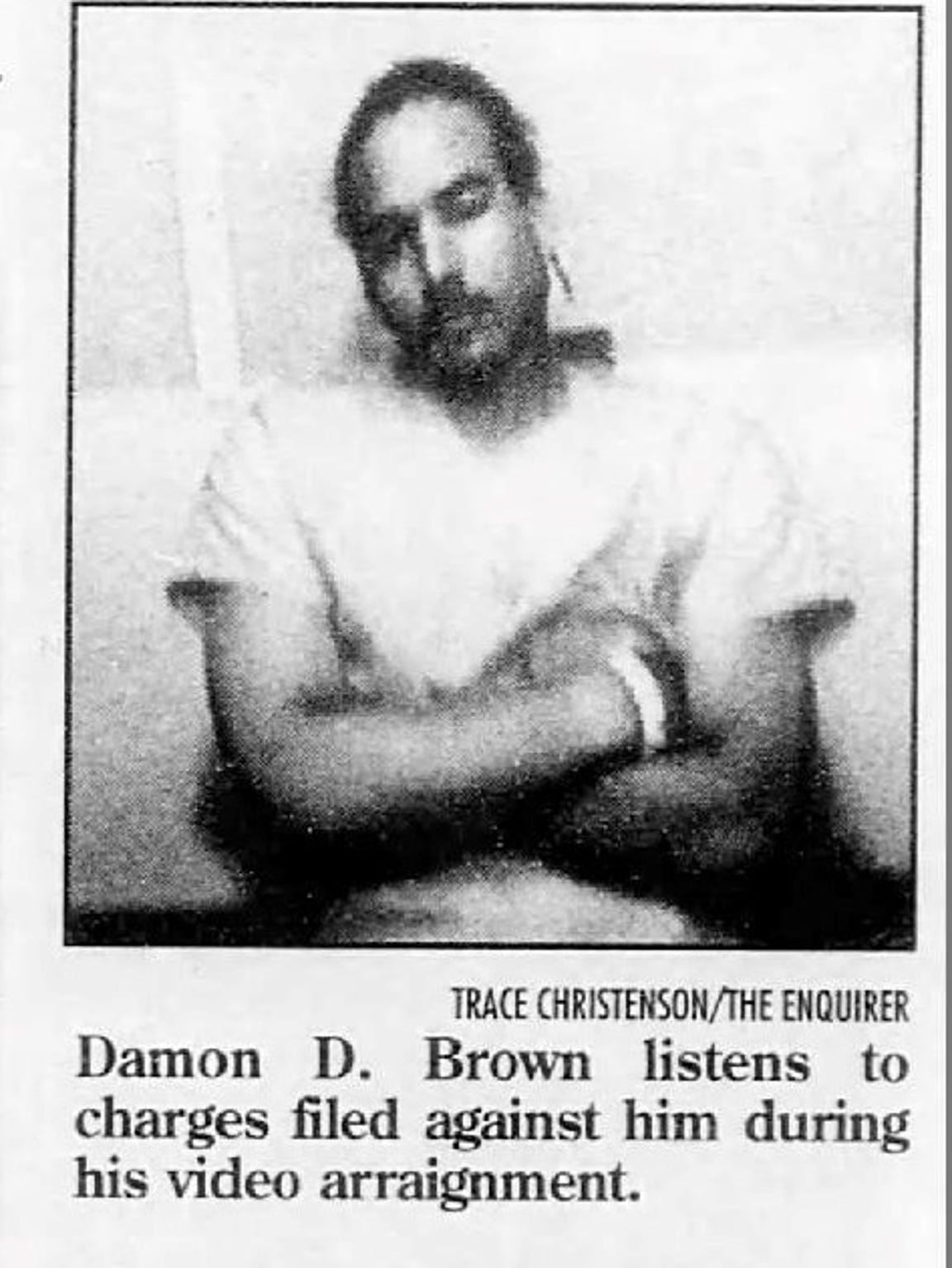 In this 1996 photo, Damon Brown listens to charges