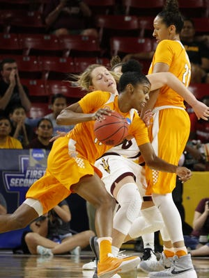 Tennessee's Mercedes Russell (21) sets a screen on ASU's Kelsey Moos (24) for teammate Diamond DeShields to go around during the second round of the Women's NCAA Tournament at Wells Fargo Arena in Tempe, Ariz. on Sunday, March 20, 2016.