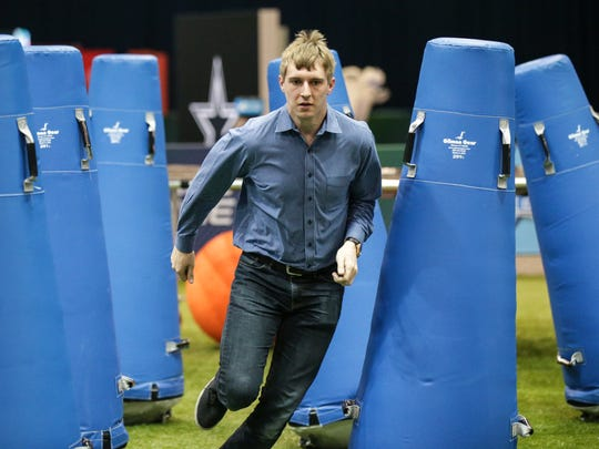 Indy Star intern Jordan Wilson runs the obstacle course at the NFL Combine Fan Experience, March 1, 2017. The combine opens to the public on March 2.