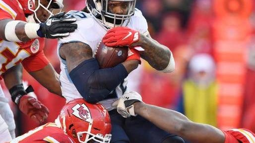 Titans running back Derrick Henry (22) runs against the Kansas City Chiefs defense during the AFC Championship game in Kansas City, Mo. on January 19.
