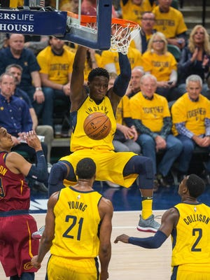 Indiana Pacers guard Victor Oladipo (4) slam dunks the ball as Cleveland Cavaliers guard Jordan Clarkson (8) defends in the first quarter of game six of the first round of the 2018 NBA Playoffs at Bankers Life Fieldhouse.