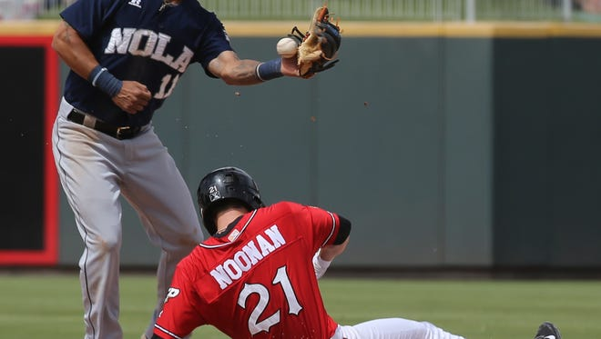 El Paso baserunner Nick Noonan beat a pickoff to second base as the ball caromed off of New Orleans shortstop Robert Andino's wrist Sunday.