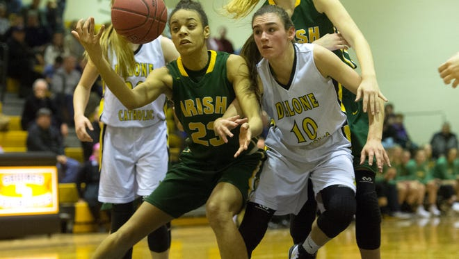 York Catholic's Jania Wright (23) and Delone's Maddie Clabaugh (10) compete for a loose ball, Friday, Jan. 5, 2018. The Delone Catholic Squirettes topped the York Catholic Fighting Iris, 49-42.
