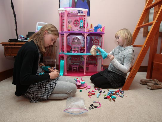 LaJuan Culley, 10, left, and her stepsister Kayla Hatfield,