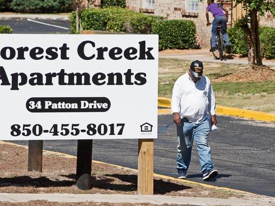 Activist Ellison Bennett informs residents of Forest