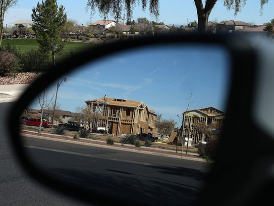 New homes are under construction at a housing development