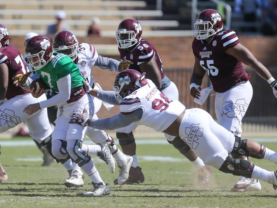 Maroon group member's Nick Fitzgerald  (7) escapes the