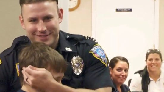 9-year-old boy chases down cops to give them this