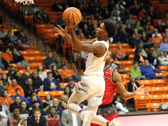 UTEP's Omega Harris drives for a layup Tuesday night.