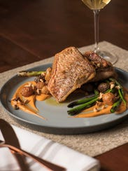 Pan-seared Gulf snapper with patatas bravas and Romesco