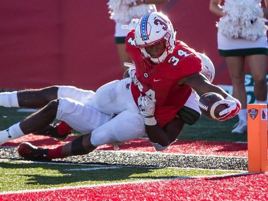 Ball State's James Gilbert reaches for the pylon against
