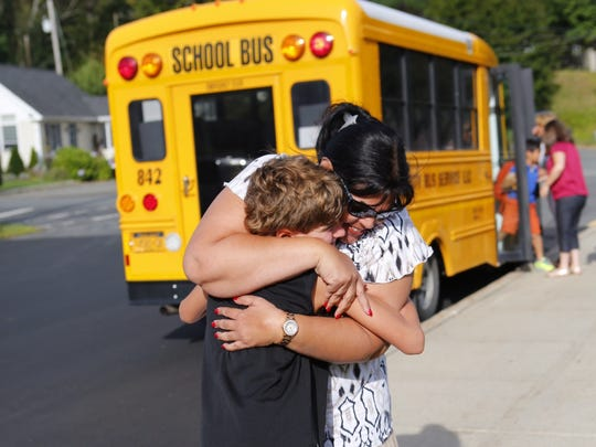 Fourth-grade teacher Ena Virola greets a student on the first day of school at Ramapo Central's Sloatsburg Elementary School, Sept. 3, 2014.