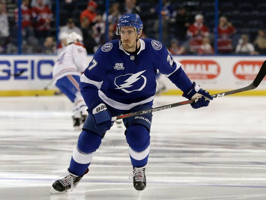 FILE - In this March 10, 2018, file photo, Tampa Bay Lightning defenseman Ryan McDonagh (27) skates in warm-ups prior to an NHL hockey game against the Montreal Canadiens, in Tampa, Fla. The Tampa Bay Lightning have signed defenseman Ryan McDonagh to a $47.25 million, seven-year contract extension. The deal begins with the 2019-20 season. General manager Steve Yzerman announced the contract Sunday, minutes after the Lightning and McDonagh were eligible to ink the extension.(AP Photo/Chris O'Meara, File)
