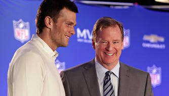 New England Patriots quarterback Tom Brady, left, poses with NFL Commissioner Roger Goodell during a news conference in February 2015 where Brady was presented the Super Bowl MVP award.