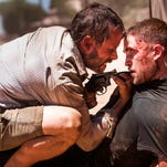 Guy Pearce (left) and Robert Pattinson get down to the nitty gritty in 'The Rover.'