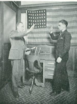 A Kohler Co. employee taking the oath of allegiance in 1926. He is a new citizen of the U.S.