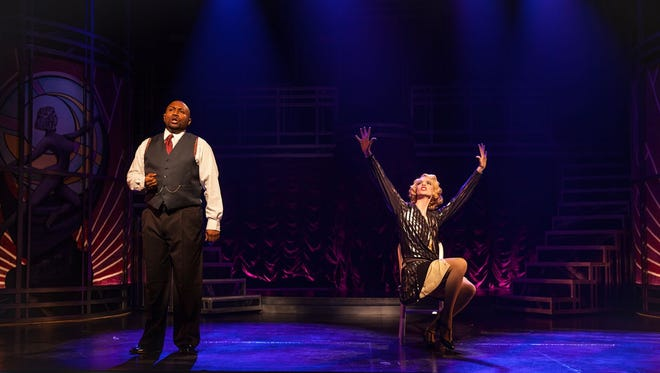 """Walter Belcher as Billy Flynn and Kate E. Cook as Roxie Hart in Phoenix Theatre's """"Chicago."""""""