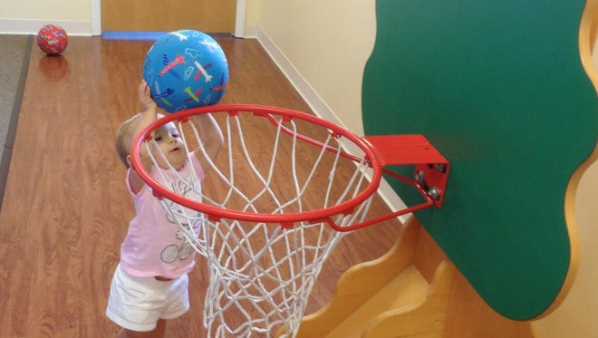 Isabella shows her slam dunking skills that she's been honing for months now.