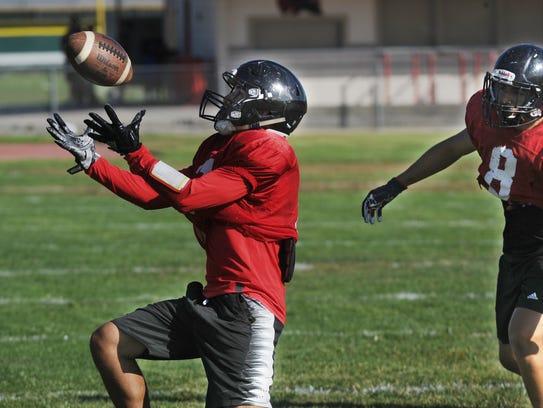 Jesus Olguin grabs an onside kick at a Rio Mesa practice