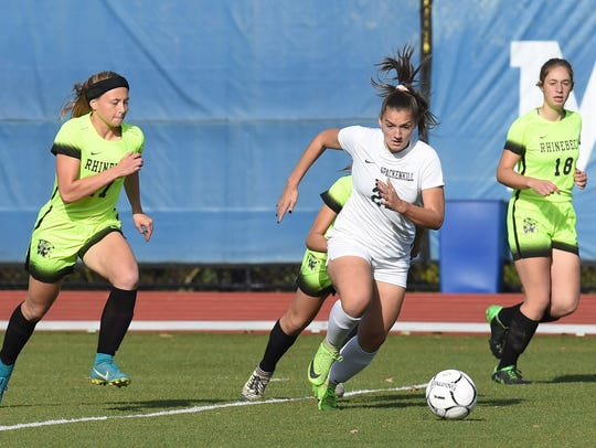 Spackenkill's Mckenzie Dominick, center, chases the