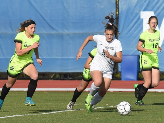 Spackenkill's Mckenzie Dominick, center, chases the ball during Friday's Class B girls soccer final against Rhinebeck at Middletown High School.