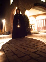 Thea Lewis leads the Queen City Ghostwalk through downtown