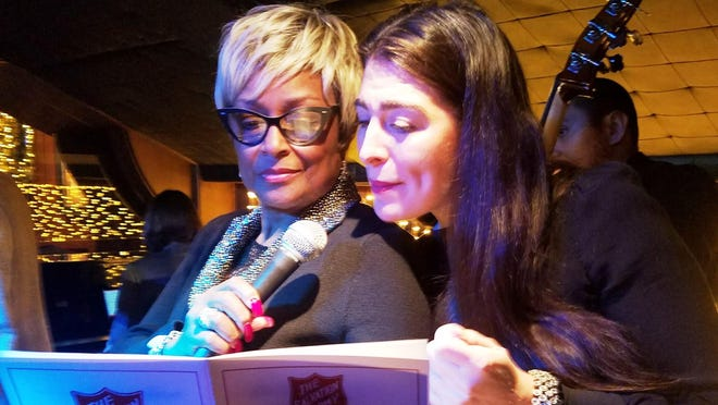 Millie Scott and Nicole New sing Christmas carols at The London Chop House event.