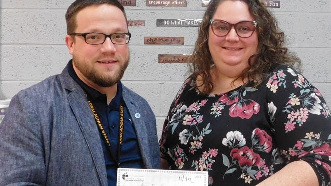 Pictured is last year's Superintendent's Challenge winner, Gwen Thurston receiving her check from principal, William Bylan, Havelock Middle.