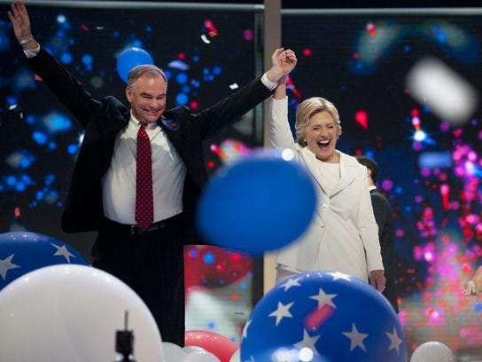 Tim Kaine and Hillary Clinton celebrate at the Democratic