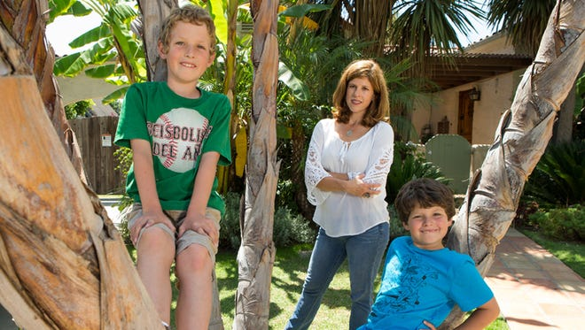 Yvonne Condes, with sons Henry, 8, left, and Alec, 9.