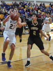 Wylie's Dylan Isenhower drives to the basket as Amarillo High's Jake Lambert defends. The Bulldogs beat Amarillo High 60-58 in the Catclaw Classic title game Saturday, Dec. 9, 2017 at Bulldog Gym.
