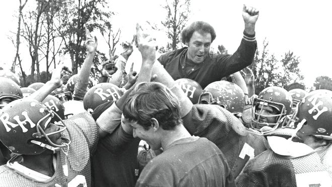 Ridgeway coach Sonny Winters enjoys a congratulatory boost from his players on November 5, 1975, upon learning the Roadrunners had been selected to meet Jackson Southside in the Ruritan Bowl November 15 in Jackson, Tennessee. It will be the first bowl appearance in the five-year history of Ridgeway football. Winters is in only his second season as head coach.