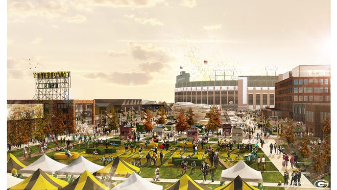 An artist's conceptual rendering shows a fall scene in the Titletown District?s public plaza, with Lambeau Field in the background. Final designs might differ. Nearly one-third of the 34-acre development will be public plaza, including an ice skating pond in winter, an event area and green space.