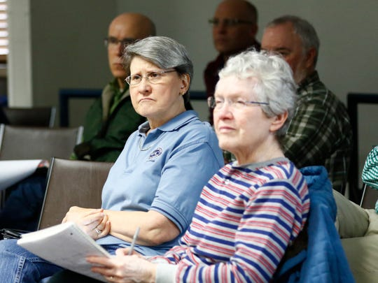 Attendees listen while hee Center for Media and Democracy's Deputy Director Mary Bottari, makes a speech during Wednesday's Open Government Roadshow at the Marathon County Public Library in Wausau.