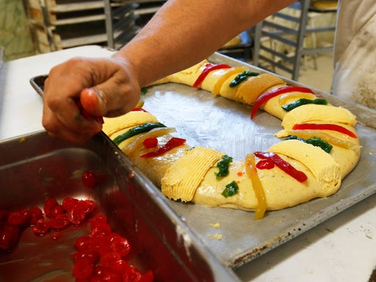 One of several bakers at El Fenix Bakery in El Paso's lower valley puts the final touches on a Rosca De Reyes cake Friday morning, by the end of the day 300 of the holiday roscas will be made followed up by 400 on Saturday. For over thirty nine years Francisco Garcia has followed his fathers recipe and continued the family tradition of making the roscas at the family bakery.