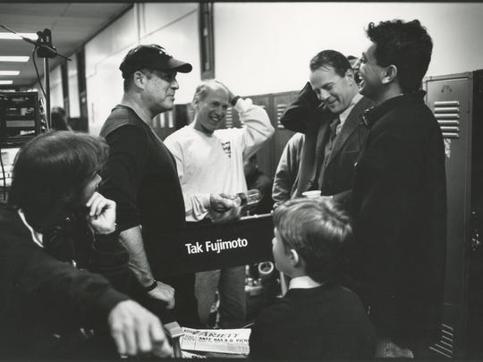 David Vogel, producer Frank Marshall, actor Bruce Willis, director M. Night Shyamalan, and actor Haley Joel Osment share a laugh on the set of The Sixth Sense.