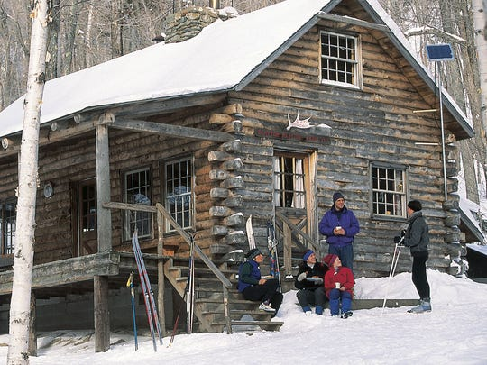 Skiers enjoy a snack and warm beverage after making the rewarding trek up to the Slayton Pasture Cabin.