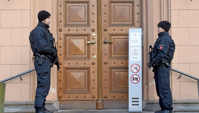 Policemen secure an entrance to the Higher Regional Court in Celle near Hanover, northern Germany, where a verdict was expected against suspected jihadist girl Safia S on Jan. 26, 2017.