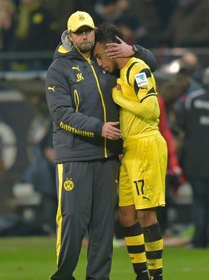 Dortmund head coach Juergen Klopp comforts Pierre-Emerick Aubameyang.
