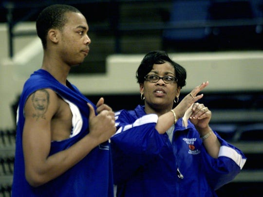 Tennessee State University Athletic Director Teresa Phillips talks with Jeremy Jackson during the men's team practice on Feb. 12, 2003.