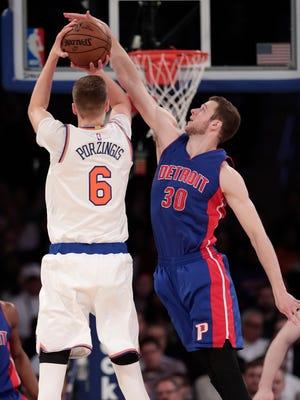 Knicks forward Kristaps Porzingis is fouled while shooting by Pistons forward Jon Leuer in New York last season.