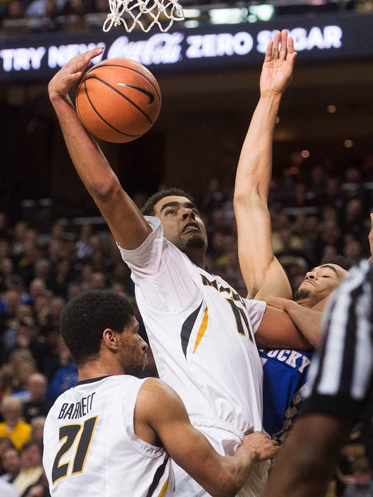Missouri's Jontay Porter, left, pulls down a rebound over teammate Jordan Barnett, left, and Kentucky's Sacha Killeya-Jones, right, during the first half of an NCAA college basketball game Saturday, Feb. 3, 2018, in Columbia, Mo. (AP Photo/L.G. Patterson)