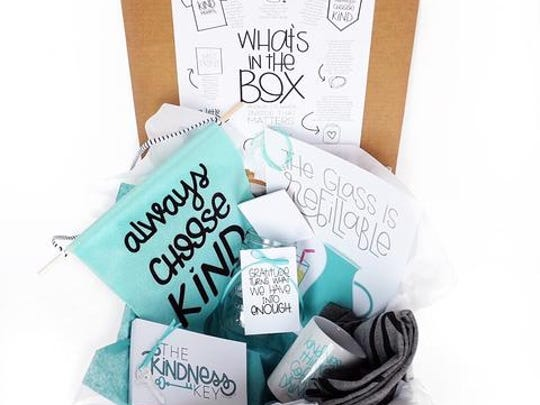 The Kindness Key is a box stuffed with products and messages of kindness, sold by Mama Said Tees.