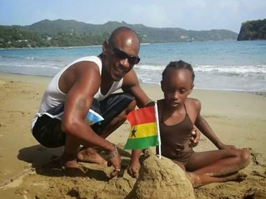 Kenroy Smith on the beach with his daughter AbbieGail