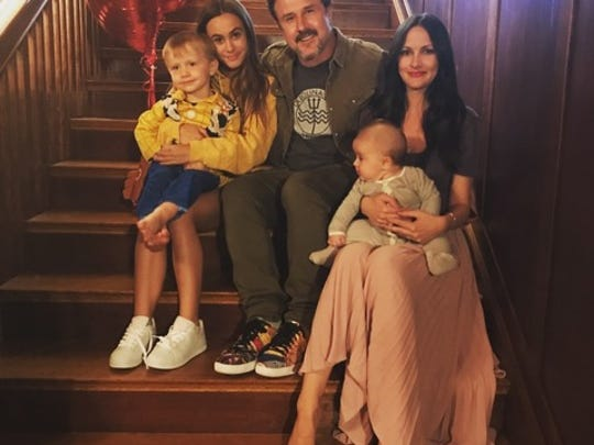 David Arquette poses with his family
