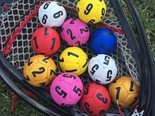 Swax Lax's goalie balls are colored and numbered for use in agility drills.