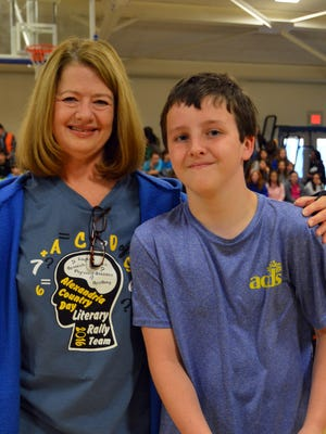 Alexandria Country Day School Headmistress Nancy Rials stands with fifth-grader Ryan Monroe, who is is one of the semifinalists eligible to compete in the 2016 Louisiana National Geographic State Bee on April 1.