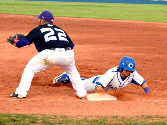Carlsbad's Tristan Walker makes it back to first base safely in game two Friday against Clovis.