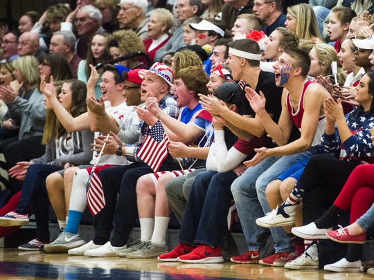 Spring Grove's student section cheers on their team during a game against Central York. Student section Austin piety is at center, to the right of the boy wearing an American flag brimmed hat.
