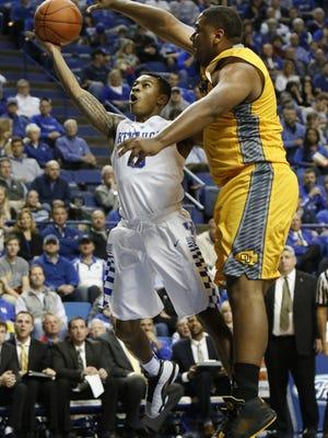 Kentucky's Tyler Ulis, left, shoots as Ottawa's John O'con defends during an NCAA college basketball exhibition game Monday, Nov. 2, 2015, in Lexington, Ky. (AP Photo/James Crisp)
